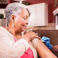 Woman receiving flu shot