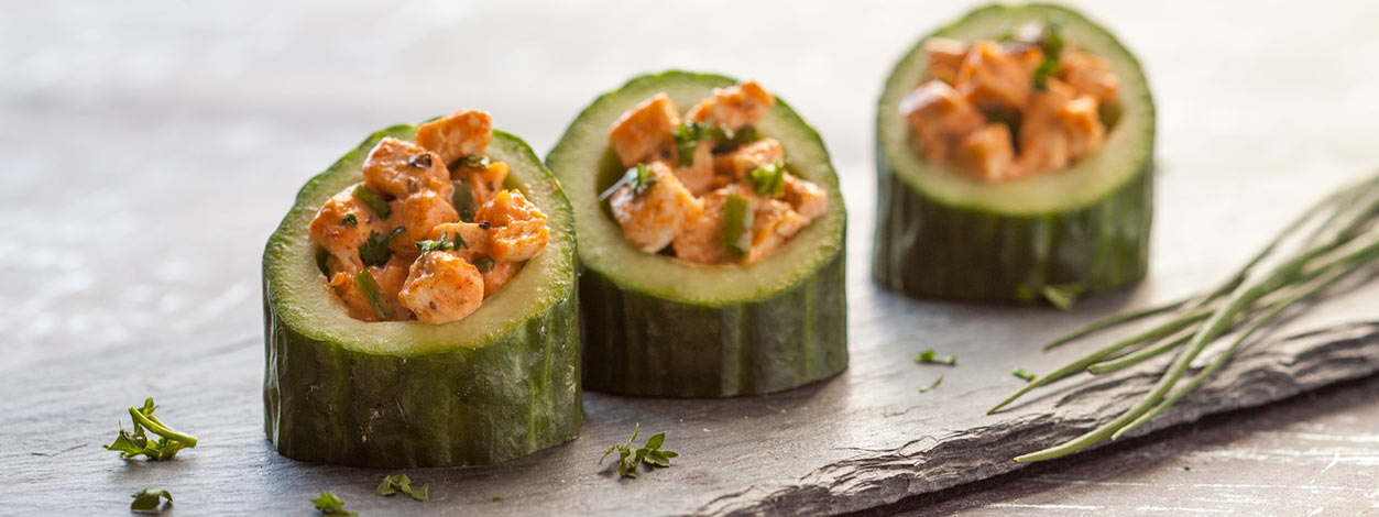 Multiple buffalo chicken salad stuffed cucumber cups enlarged